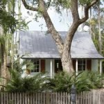 California cottage home with white picket fence